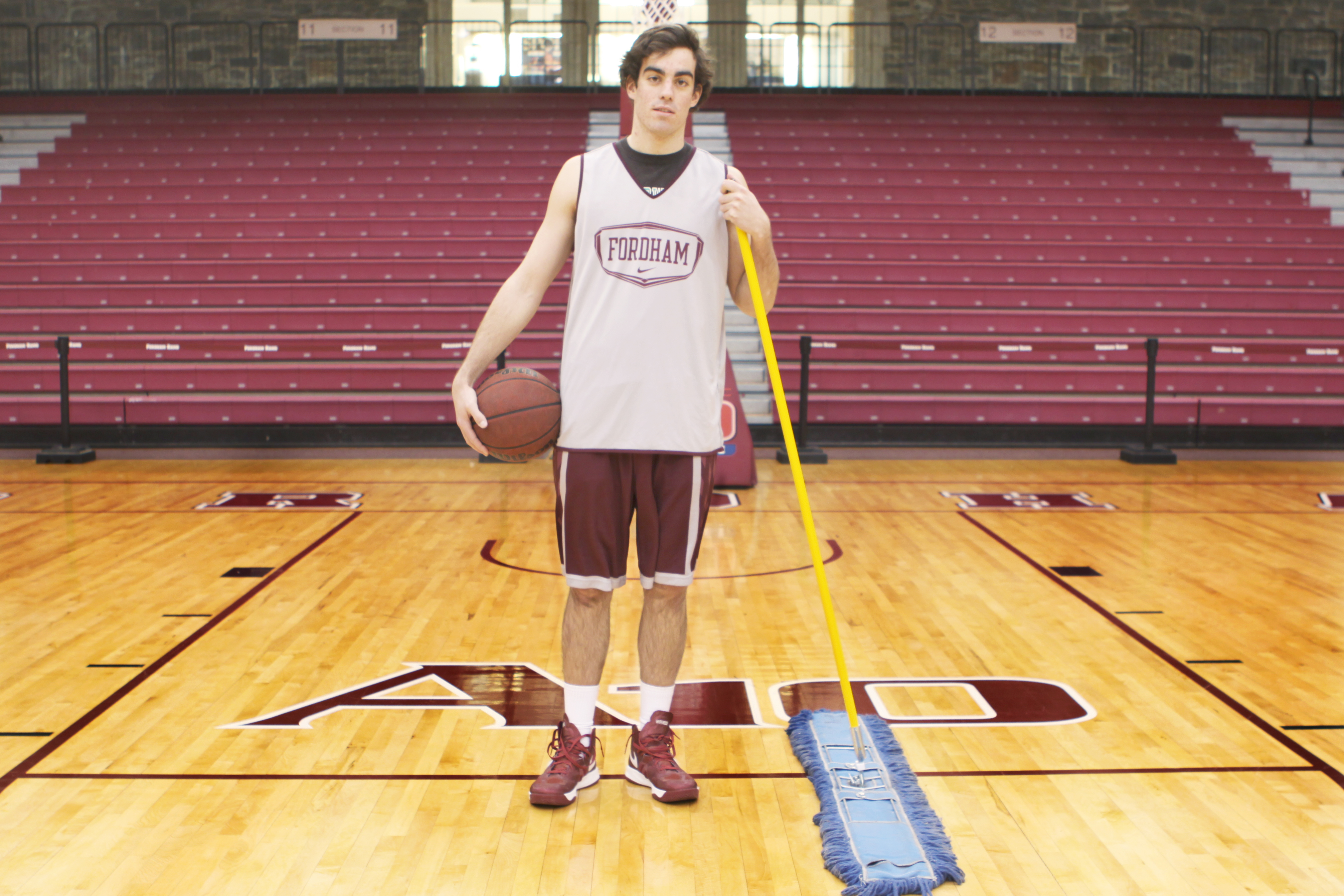 Elizabeth Zanghi/The Ram Leo Walsh, FCRH '14, worked as event staff, mopping the court at Fordham basketball games before joining the team.