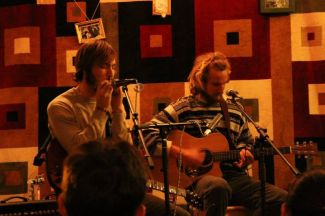 Henry Bartholomay, FCRH '14, (left) and Sean Lemkey , FCRH '14, (right), showcase their bluesy rock music style during a set at Rodrigues Coffee House. (Photo Courtesy of King Mulhacen)