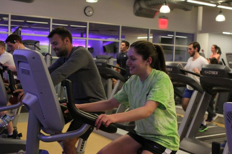 Whether it is friends or couples meeting up at the fitness center, working out for Fordham students can serve as  both a physical and social activity. (Samuel Joseph/The Ram)
