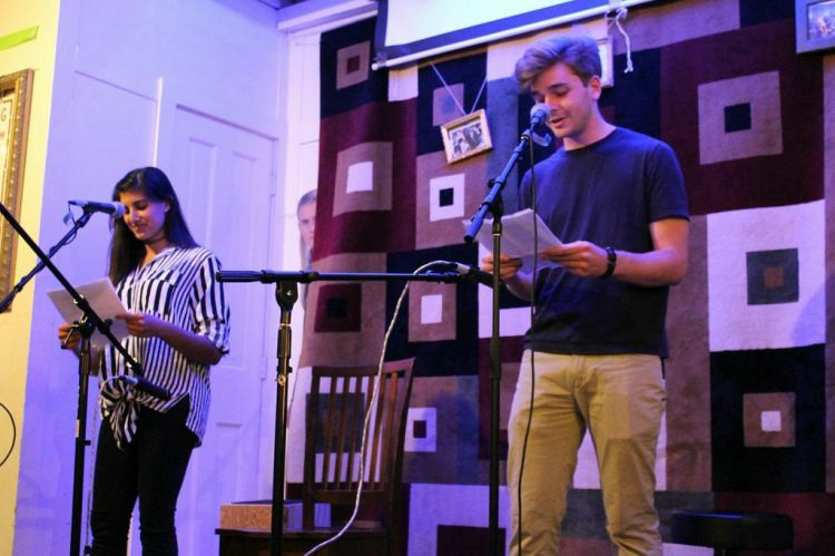 Two students take the stage for a duet at Rodrigue's as part of a large, yet intimate show that featured a variety of distinctive comedic and musical entertainment. (Renya Wang/The Ram)