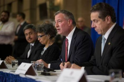 State officials, including Bill DeBlasio, recently addressed public concerns  over the ebola virus during a press conference.  John Minchillo/AP Images