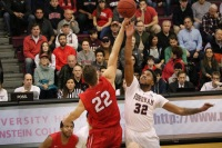 Javontae Hawkins skys for the jump ball with Davidson's Will Magarity. (Courtesy of Owen Corrigan / The Fordham Ram)