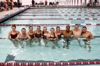 10 of the 11 senior swimmers in the pool following their final home meet. (Julia Comerford/The Fordham Ram)