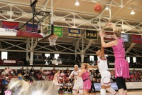 Kate Kresslina (shooting) scored 19 total points in wins vs St. Joe's and UMass (Courtesy of Erin McGreevey/The Fordham Ram).