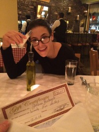 Caitlyn smiles with her one of two dinners at an Arthur Avenue classic. (Courtesy of Caitlyn Letterii)